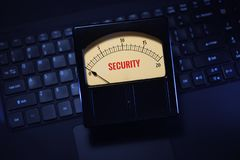 Vintage meter displaying cyber security settings on computer royalty free stock photos