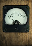 Vintage Meter on Wood Background Stock Photo
