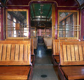 Vintage metro car. Wooden benches and chrome metal handles Royalty Free Stock Photos