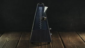 Vintage metronome beats the rhythm stock video footage