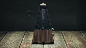 Vintage metronome beats the rhythm stock footage