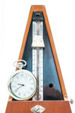 Vintage metronome and clock Stock Photo