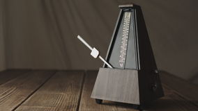 Vintage metronome, on a dark background. stock video footage