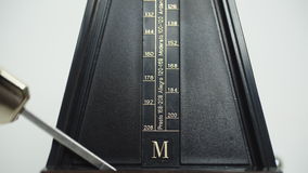 Vintage metronome, on a white background. stock footage