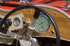 Vintage MG. British Car - Dashboard and Wheel Closeup Royalty Free Stock Photos