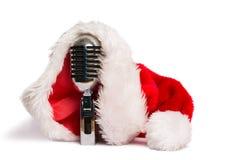 Vintage mic with santa hat. On white background Stock Image