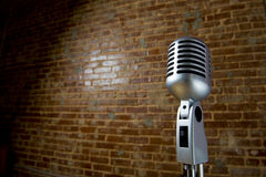 Vintage Microhone and brick wall Stock Image