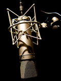 Vintage microphone. Vintage studio microphone on a cradle Royalty Free Stock Photography