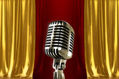 Vintage microphone. Vintage silver microphone with red gold curtains Royalty Free Stock Photo