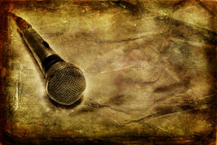 Vintage microphone. Grunge music background with dynamic microphone royalty free stock photo