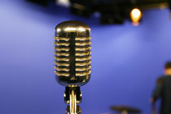Vintage microphone. Old-style chrome microphone on a blue box Stock Photography