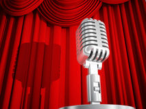 Vintage Microphone Against a Red Curtain Royalty Free Stock Photos