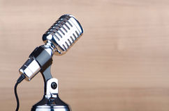 Vintage microphone against wooden background Stock Photos
