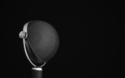 Vintage microphone on black Royalty Free Stock Photo