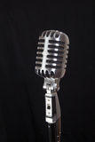 Vintage microphone, black background Royalty Free Stock Images