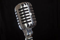 Vintage microphone on black background Royalty Free Stock Images