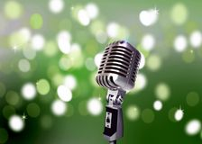 Vintage Microphone with Blur Lights Royalty Free Stock Photography