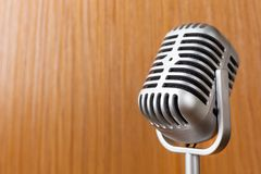 The vintage microphone close up image on wood background. Vintage microphone close up image on wood background royalty free stock image