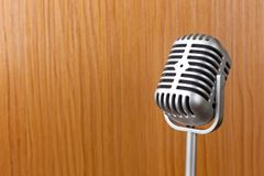 The vintage microphone close up image on wood background. Vintage microphone close up image on wood background royalty free stock photos