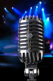 Vintage Microphone in Close-Up View. Over a stage background royalty free stock images