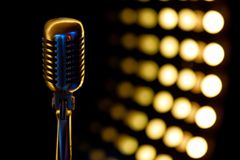 Vintage microphone with color background in nightclub royalty free stock photo