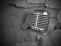 Vintage microphone on dirty background Stock Photography