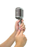 Vintage microphone with hand Royalty Free Stock Images