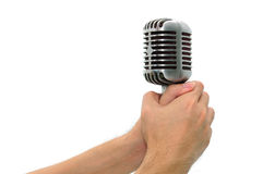 Vintage microphone with hands isolated Stock Photo
