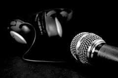 Vintage microphone and head phones Stock Images