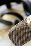 Vintage microphone with headphones Stock Photo