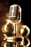 Vintage microphone, music saturated concept Stock Photography