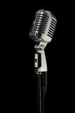 Vintage Microphone Over Black royalty free stock image