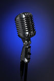 Vintage Microphone Over Blue background Stock Images