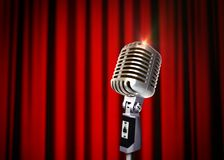 Vintage Microphone over Red Curtains Stock Images