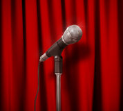 Vintage Microphone over Red Curtains. Stock Photo