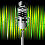 Vintage microphone over stripes Royalty Free Stock Image