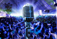 Vintage microphone and public Royalty Free Stock Image