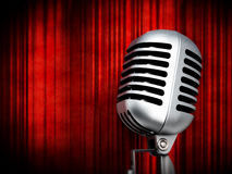 Vintage microphone on red curtains. 3D illustration Royalty Free Stock Image