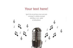 Vintage microphone with sheet music royalty free stock photos