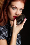 Vintage Microphone Singer. Woman singer with vintage microphone stock photo