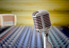 Vintage microphone in sound record room. Vintage microphone and mixer in sound record room stock photography