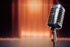 Vintage microphone at stage background Royalty Free Stock Image