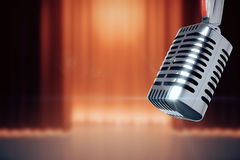 Vintage microphone at stage with the scenes background Royalty Free Stock Photos