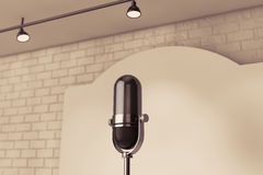 Vintage Microphone standing on an empty stage Royalty Free Stock Photos