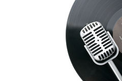 Vintage microphone and vinyl record Stock Photo