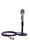 Vintage Microphone on White. A vintage looking microphone on a white background with copy space stock photo