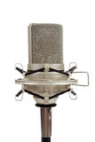 Vintage microphone on a white background. A chrome, vintage ribbon microphone on a mic stand on a white background royalty free stock photo