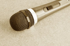 Vintage microphone on wooden background. Stock Photo