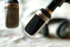 Vintage microphones with headphones Stock Images
