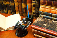 Vintage microscope and books Stock Photos